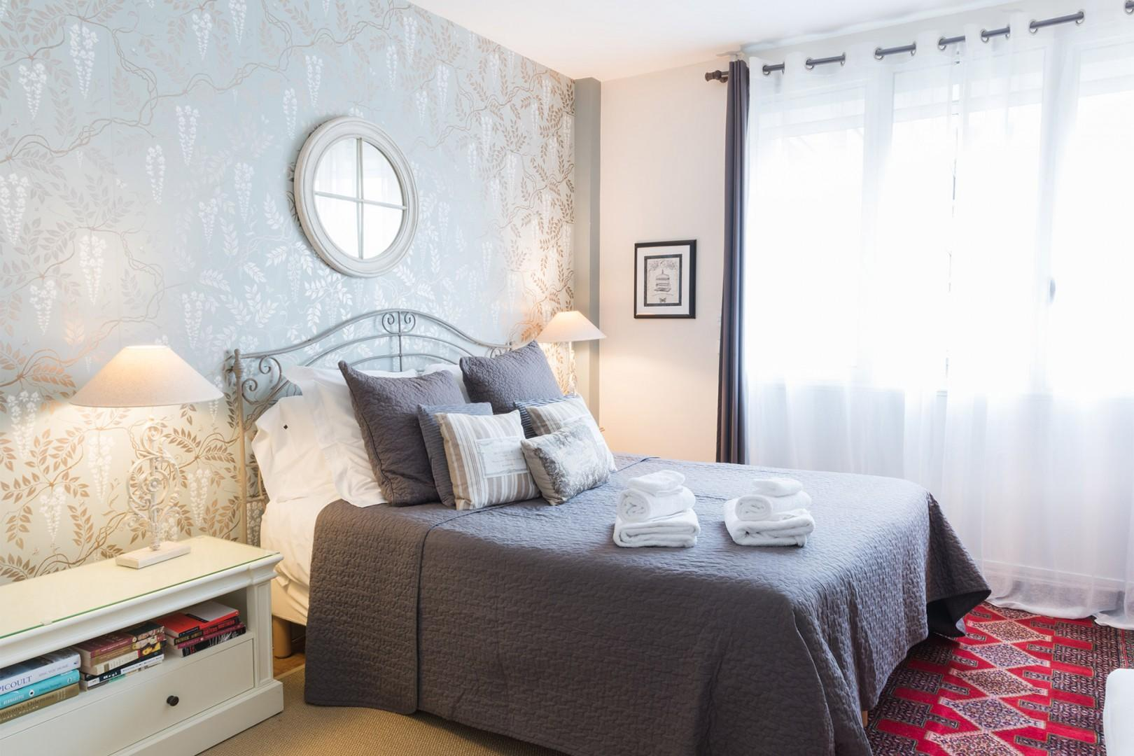 Beautiful bedroom 1 is the perfect place to unwind.