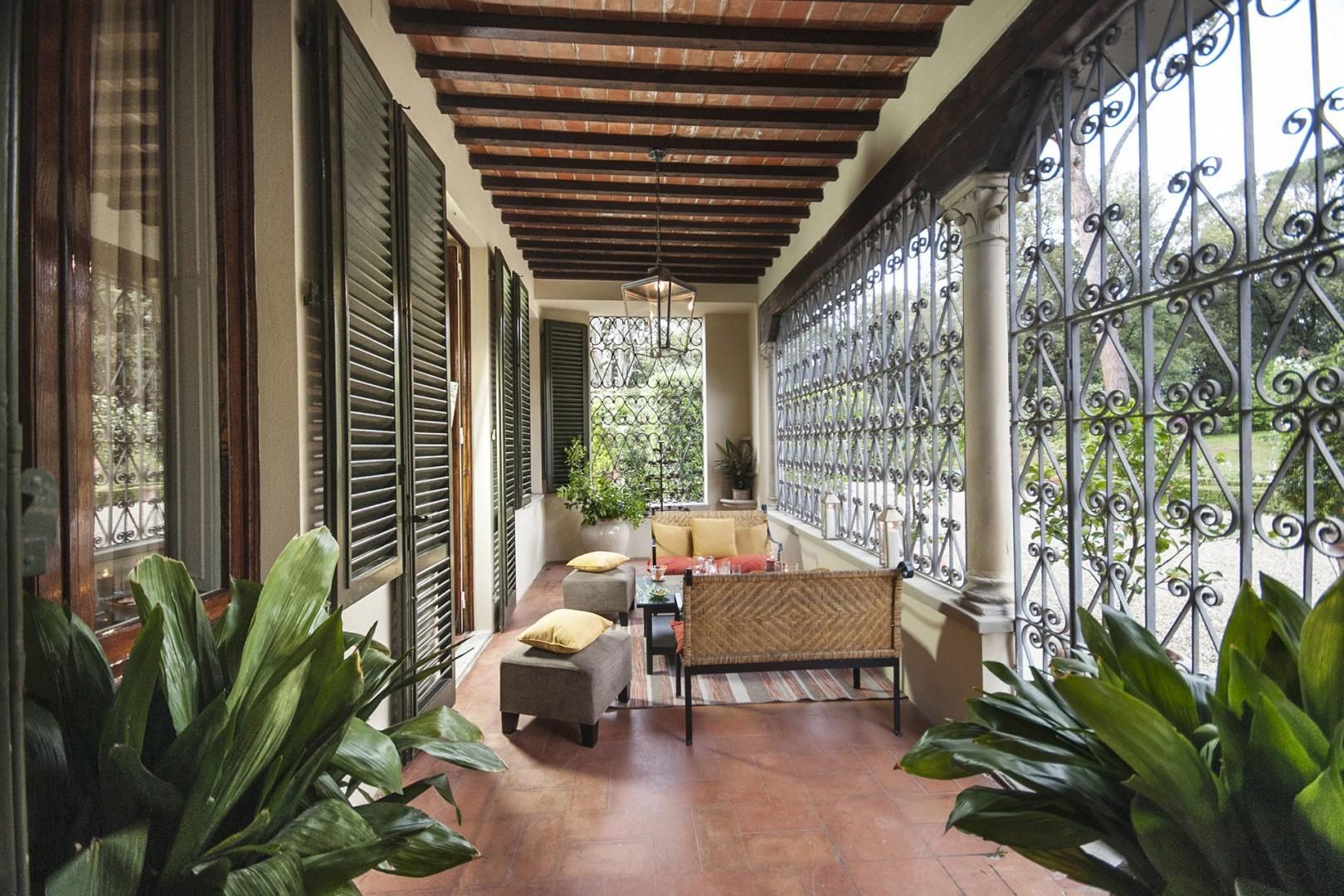 A beautiful loggia off the entry to the villa is perfect for lounging and relaxing.