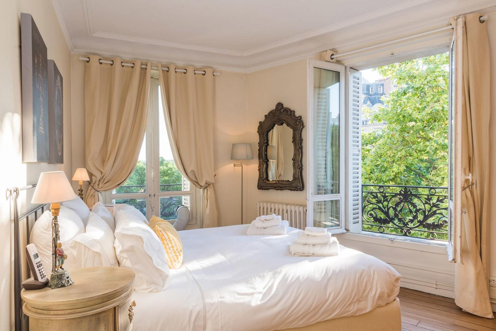 Step into the gorgeous French bedroom with a luxurious bed.