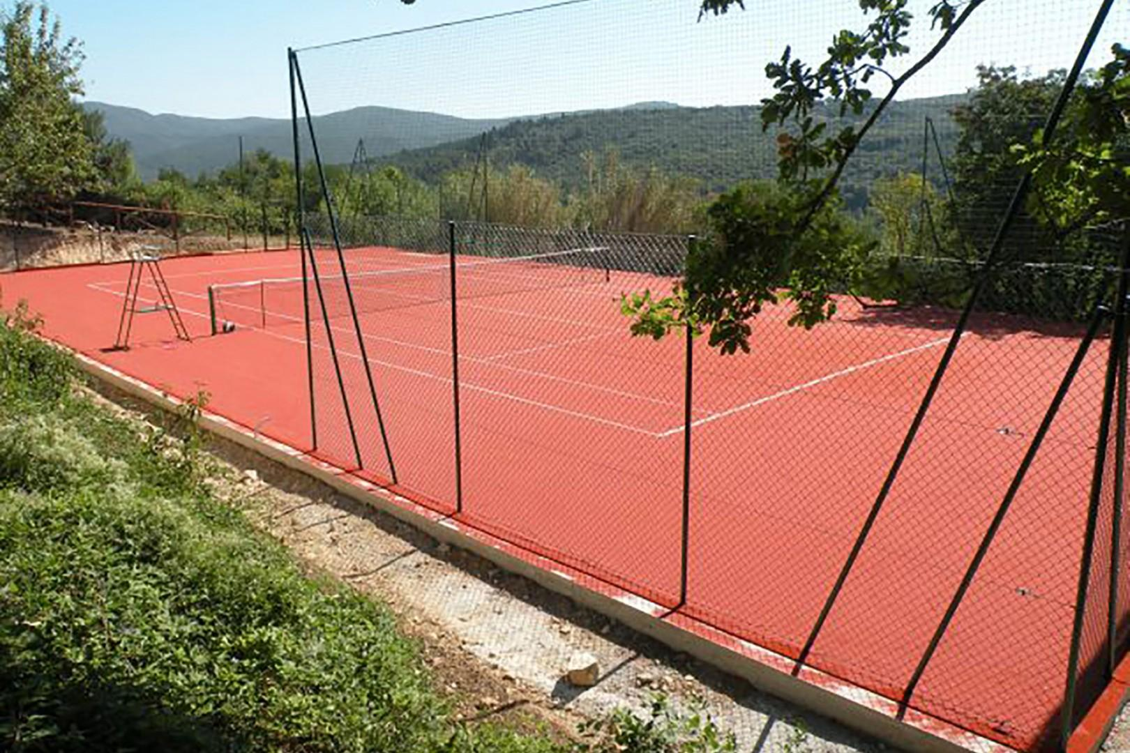 Play tennis on the private clay court.