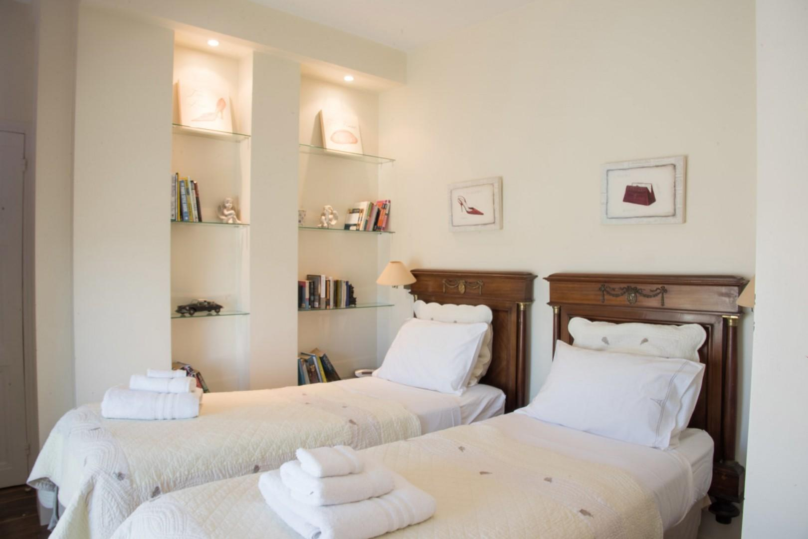 Bedroom 2 is equipped with two comfortable beds and luxurious linens.