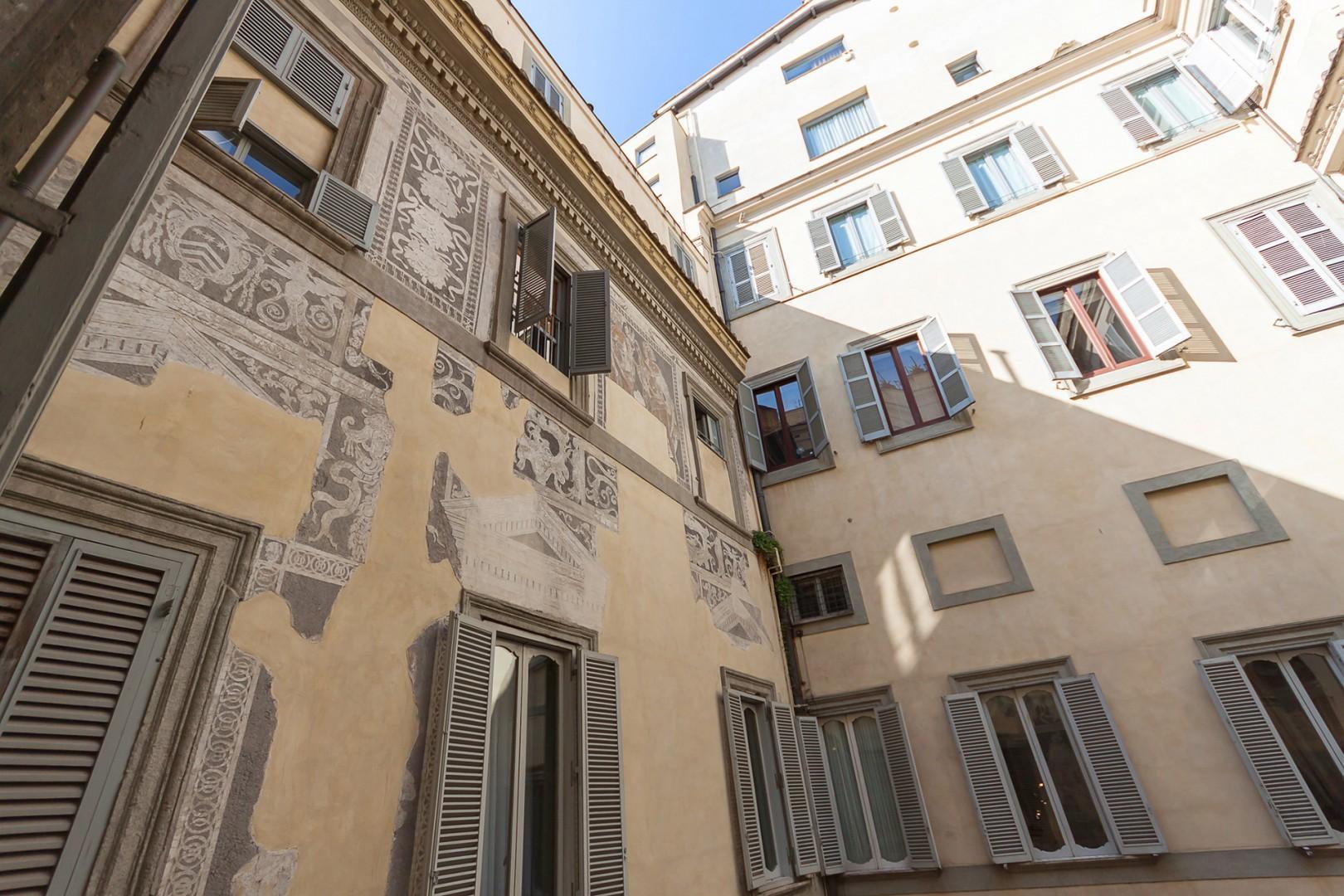 Inside the courtyard, Renaissance murals have been restored.