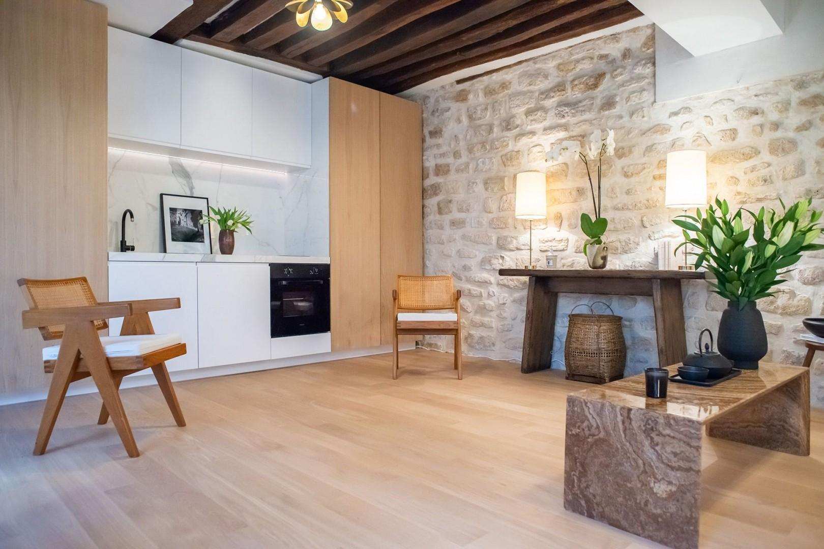 The Meunier retains its original Marais charm thanks to the wood beams and exposed stone wall.