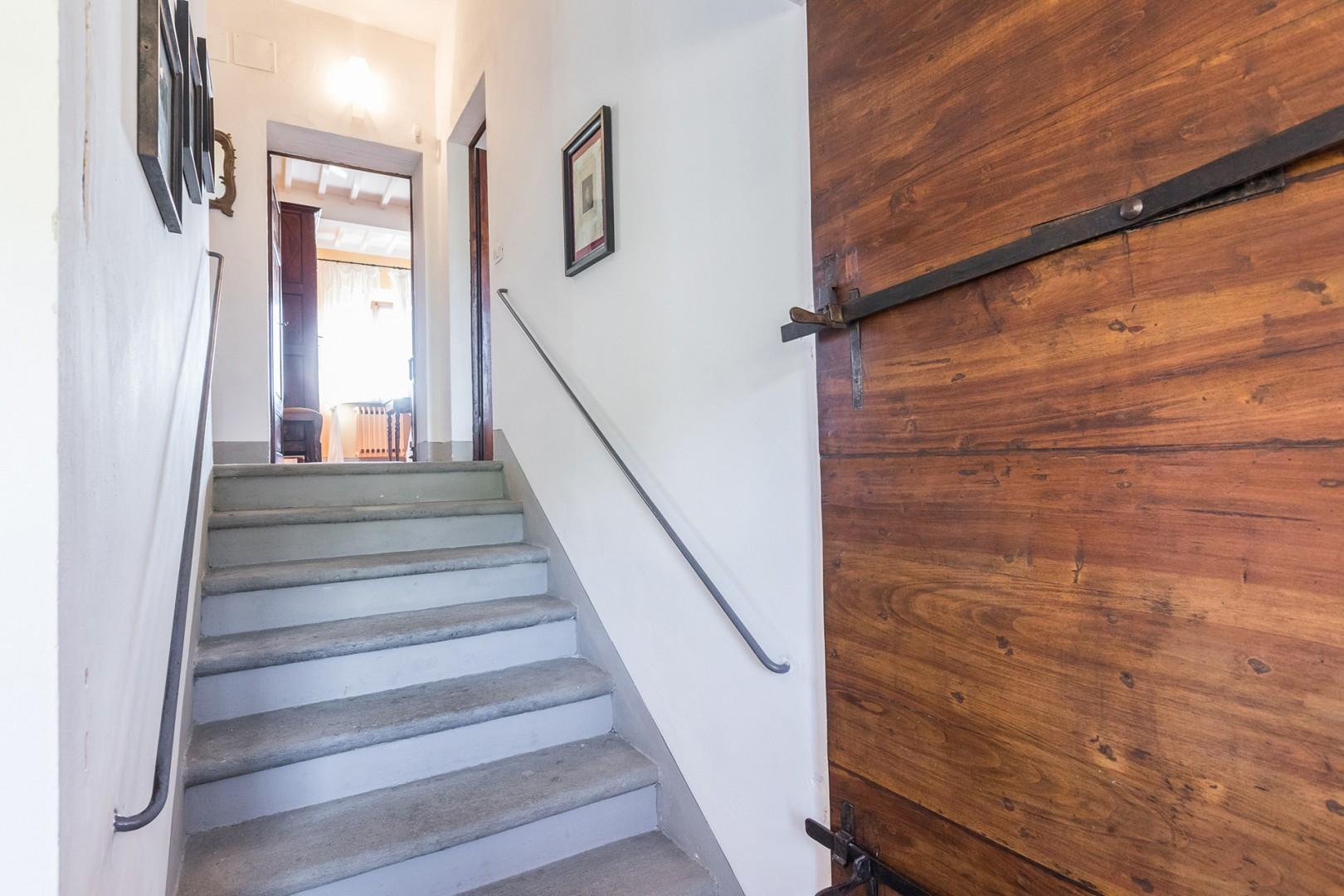 Staircase leading to the 2nd floor.