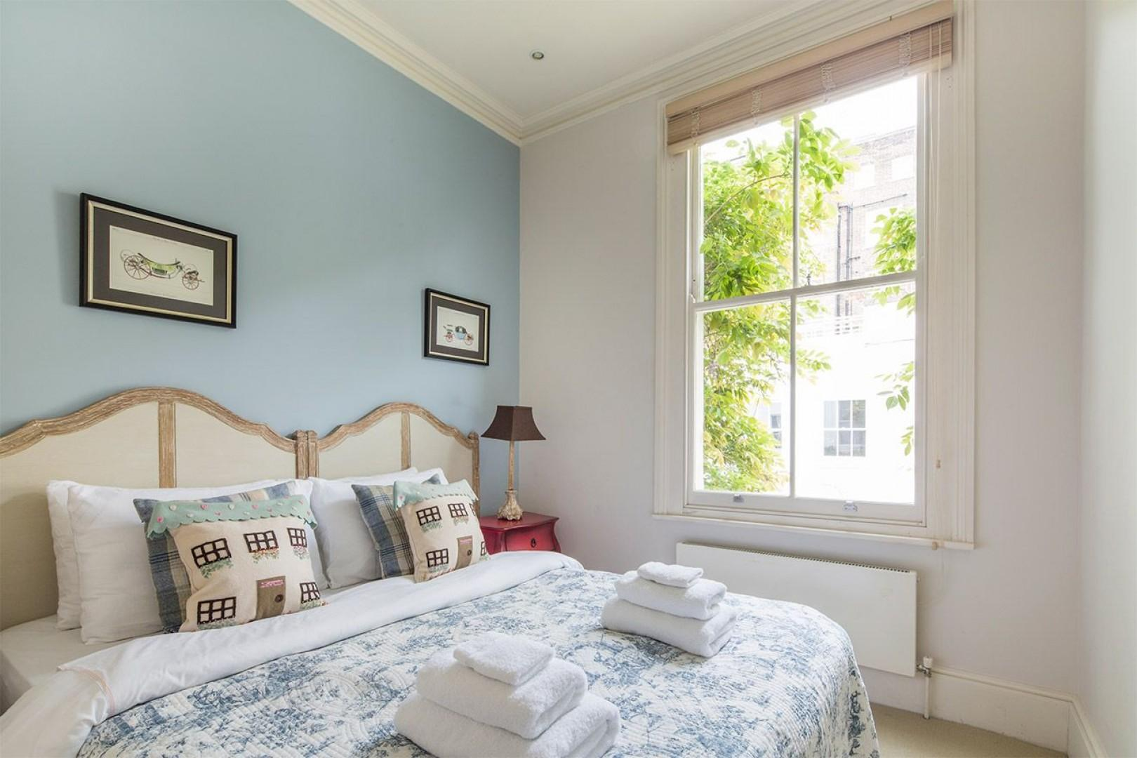 Third bedroom with a comfortable bed that can be pushed apart to form two beds and charming decor