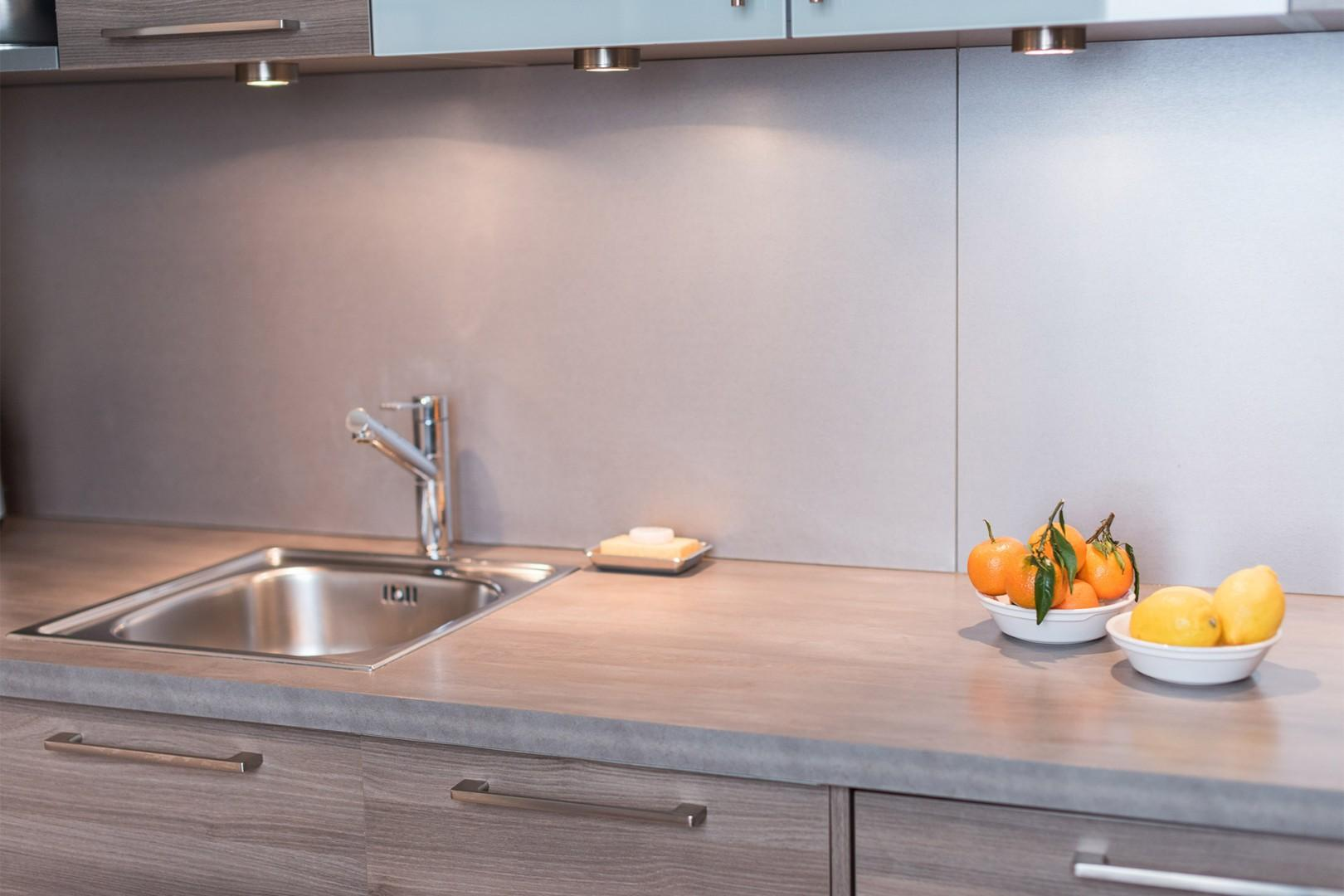 There is lots of counter space in the kitchen for your convenience.