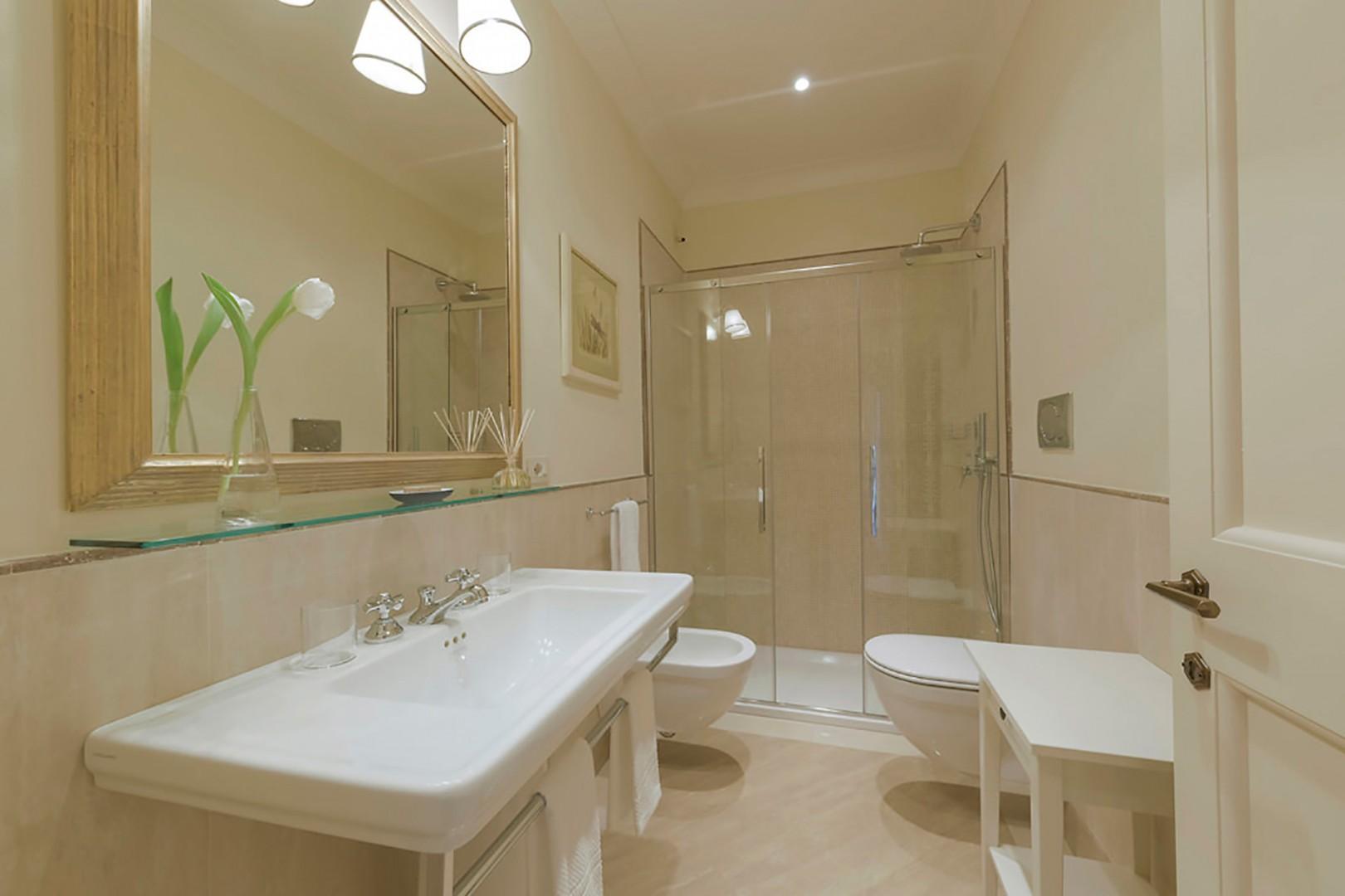 En suite bathroom to bedroom 2 with toilet, sink, shower and bidet.