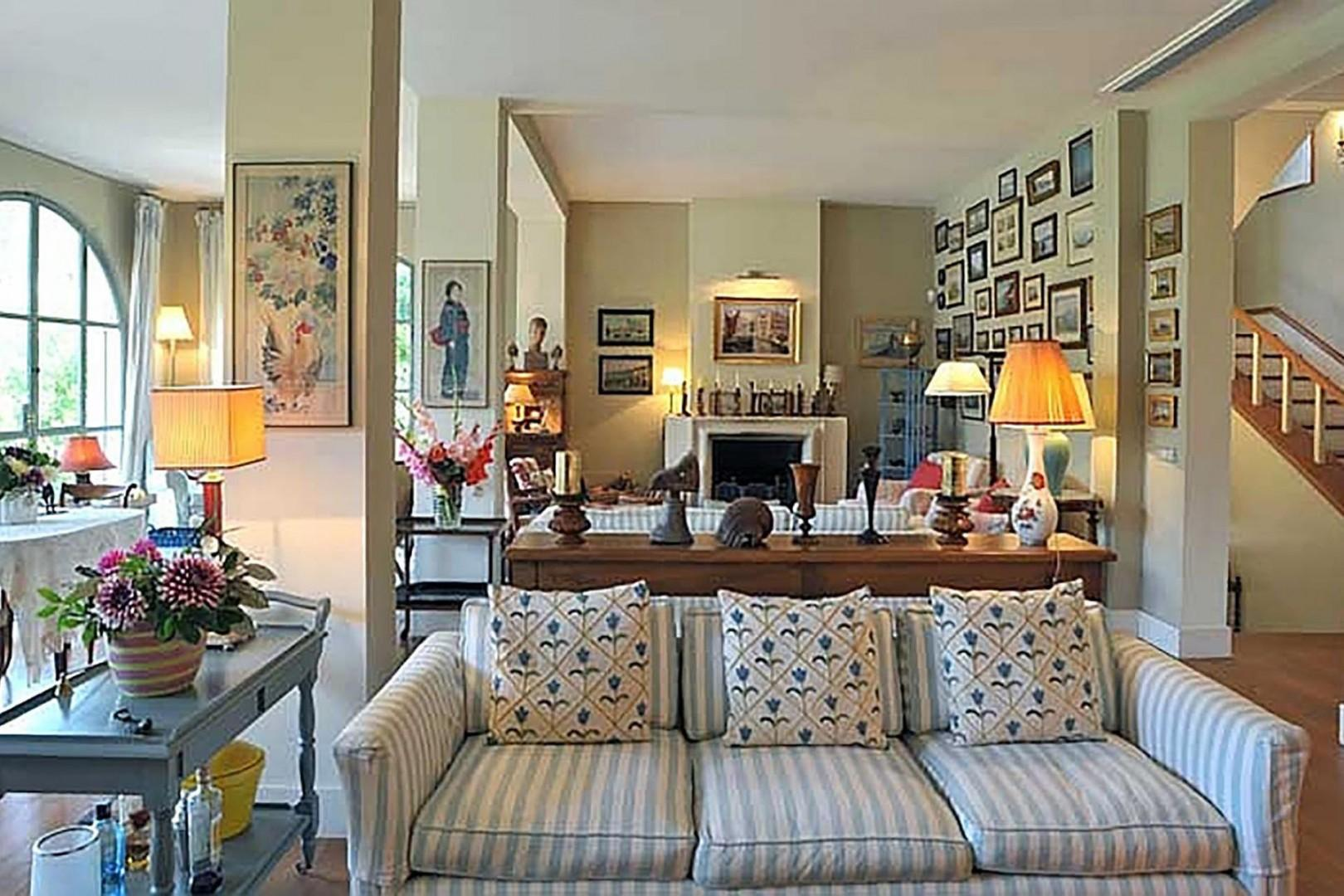 Elegant and large living room with several seating areas.