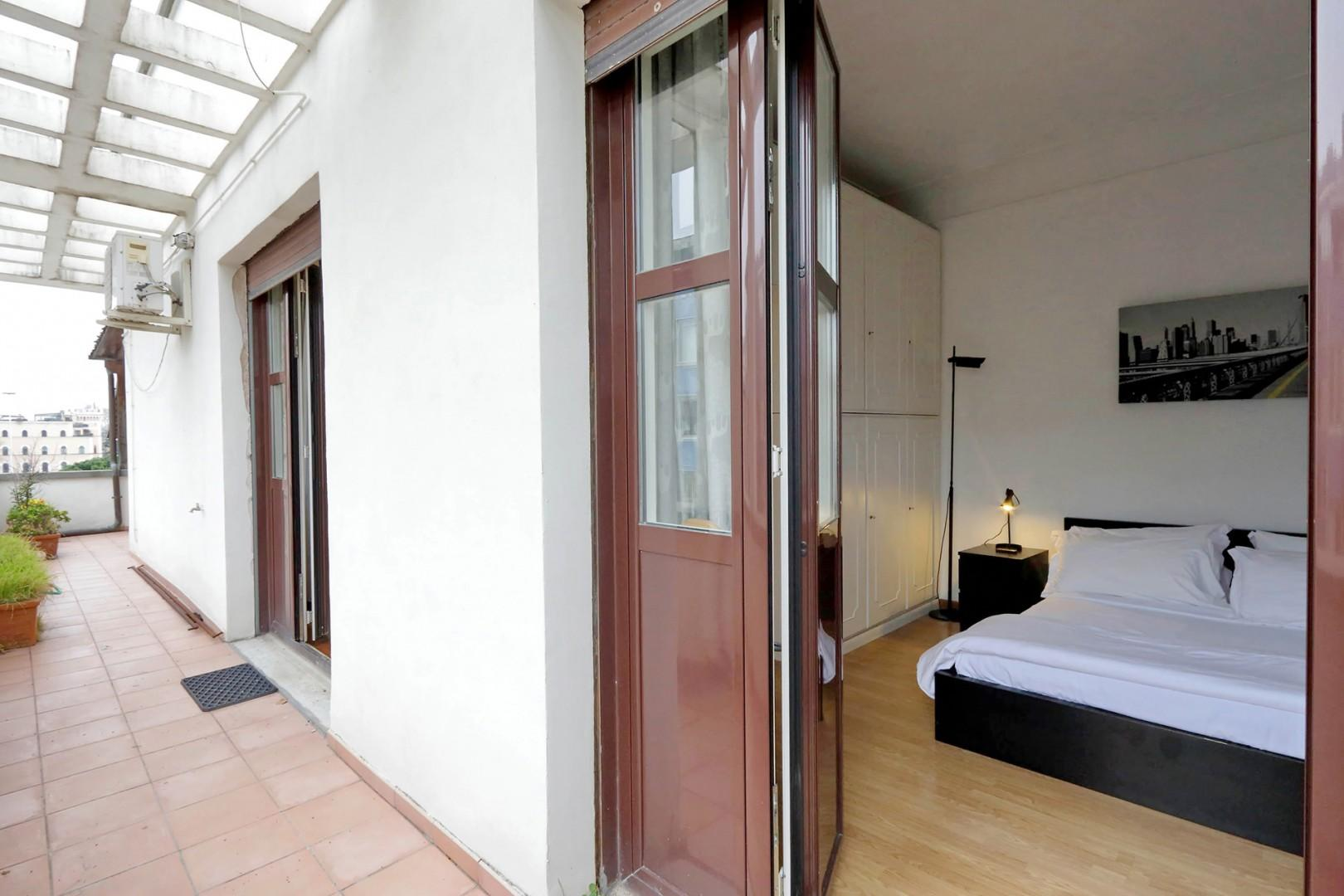 Bedroom opens to the terrace.