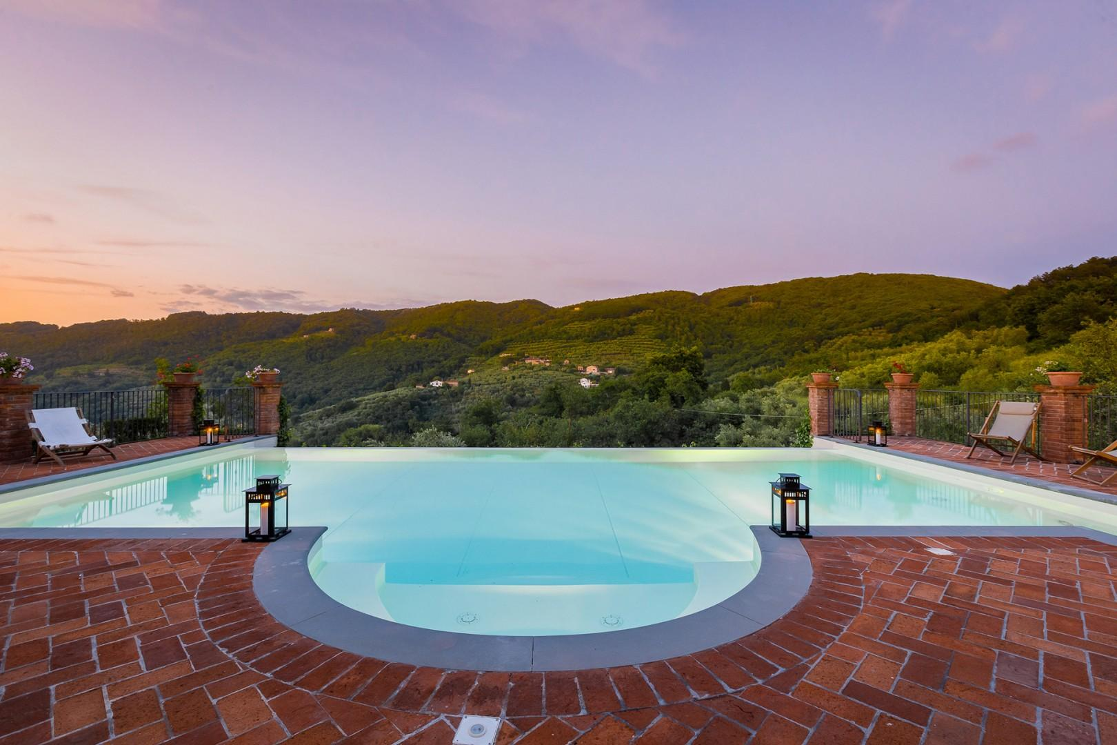 Infinity pool view of Tuscan hills.