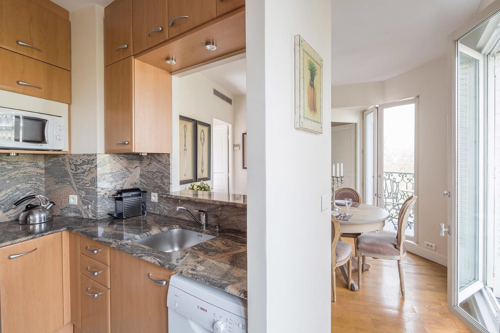 The kitchen is conveniently located next to the dining area, perfect for entertaining.