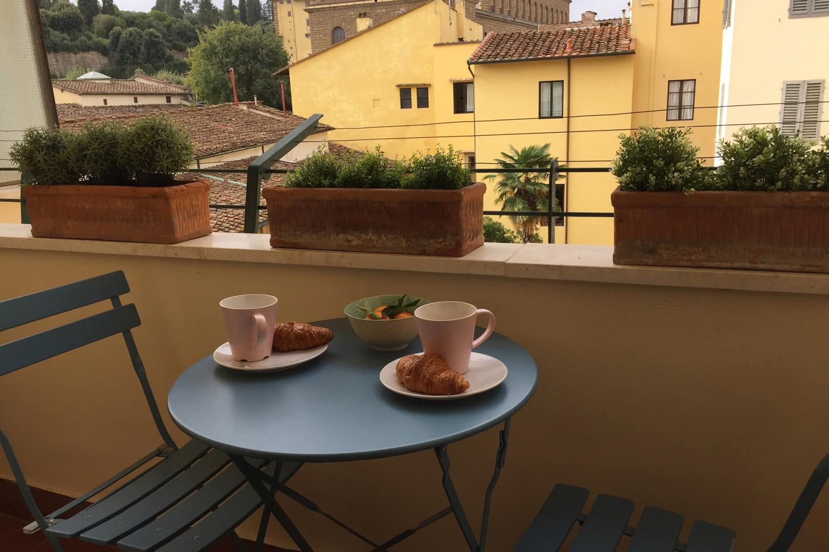 A charming small balcony with views of the Boboli Gardens and Pitti Palace.
