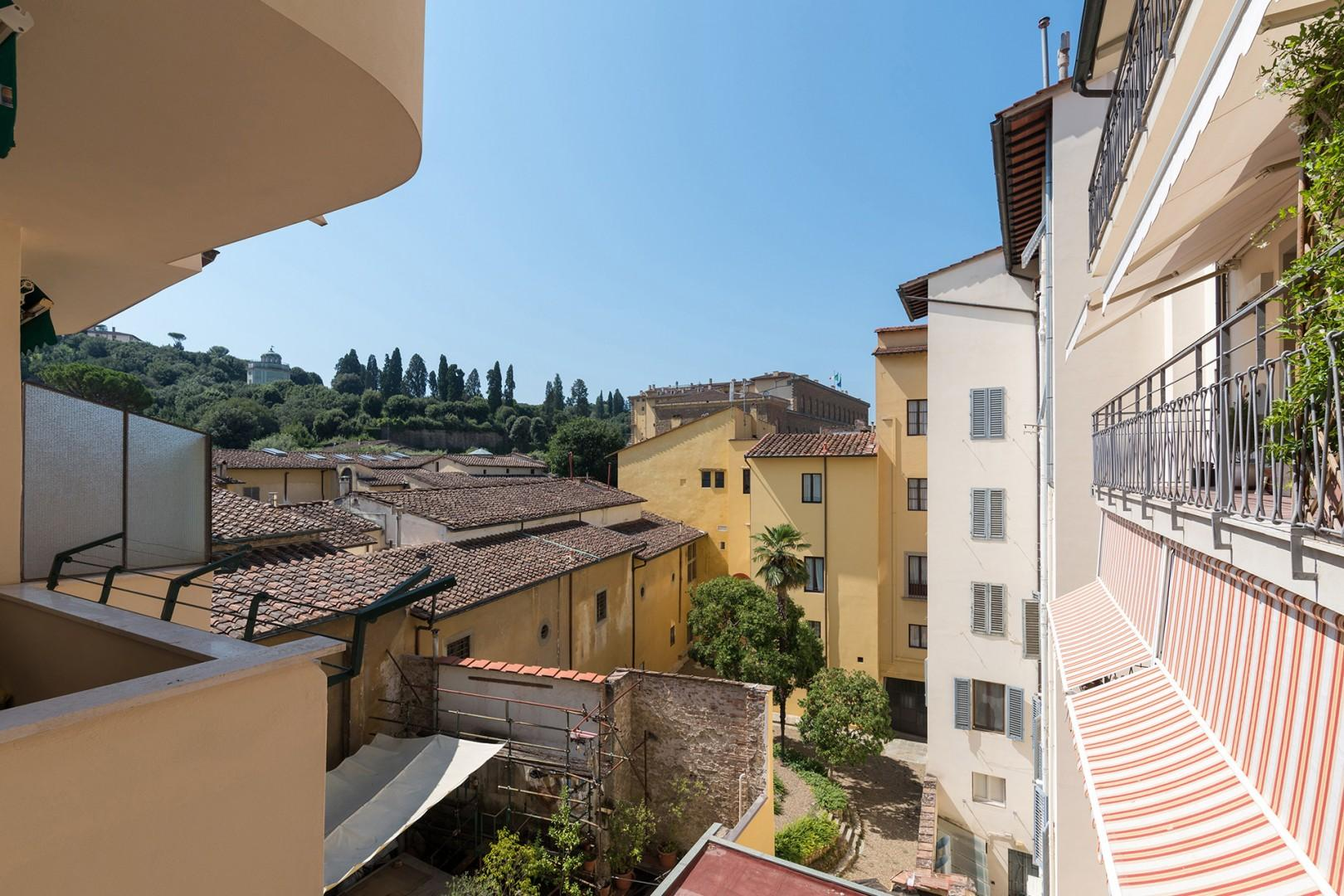 The balcony view is of the Boboli Gardens and Pitti Palace.