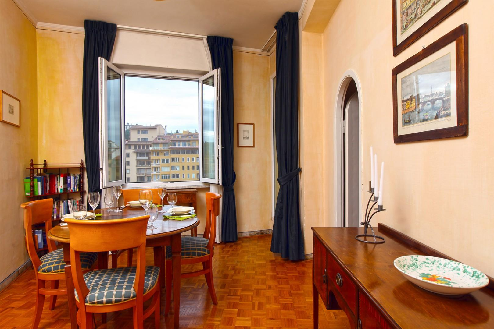 Dining room also has views out to the Arno river and terrace.