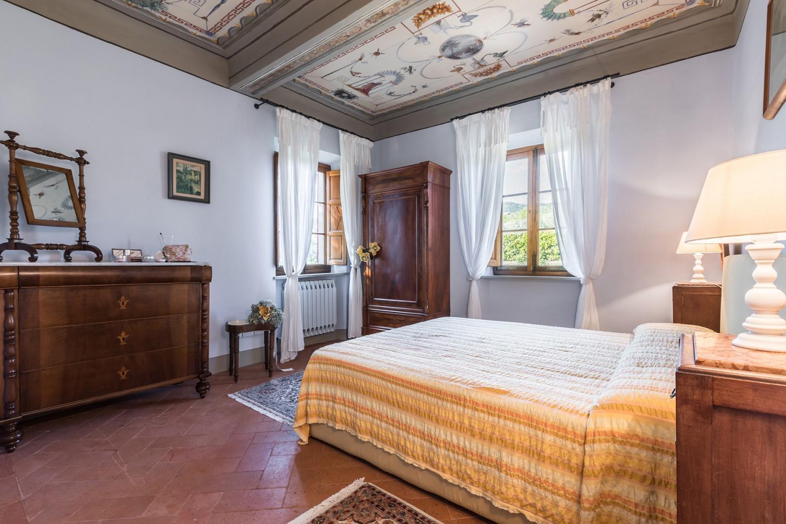 Bedroom 2 on the second floor has a beautiful frescoed ceiling and en suite bathroom.