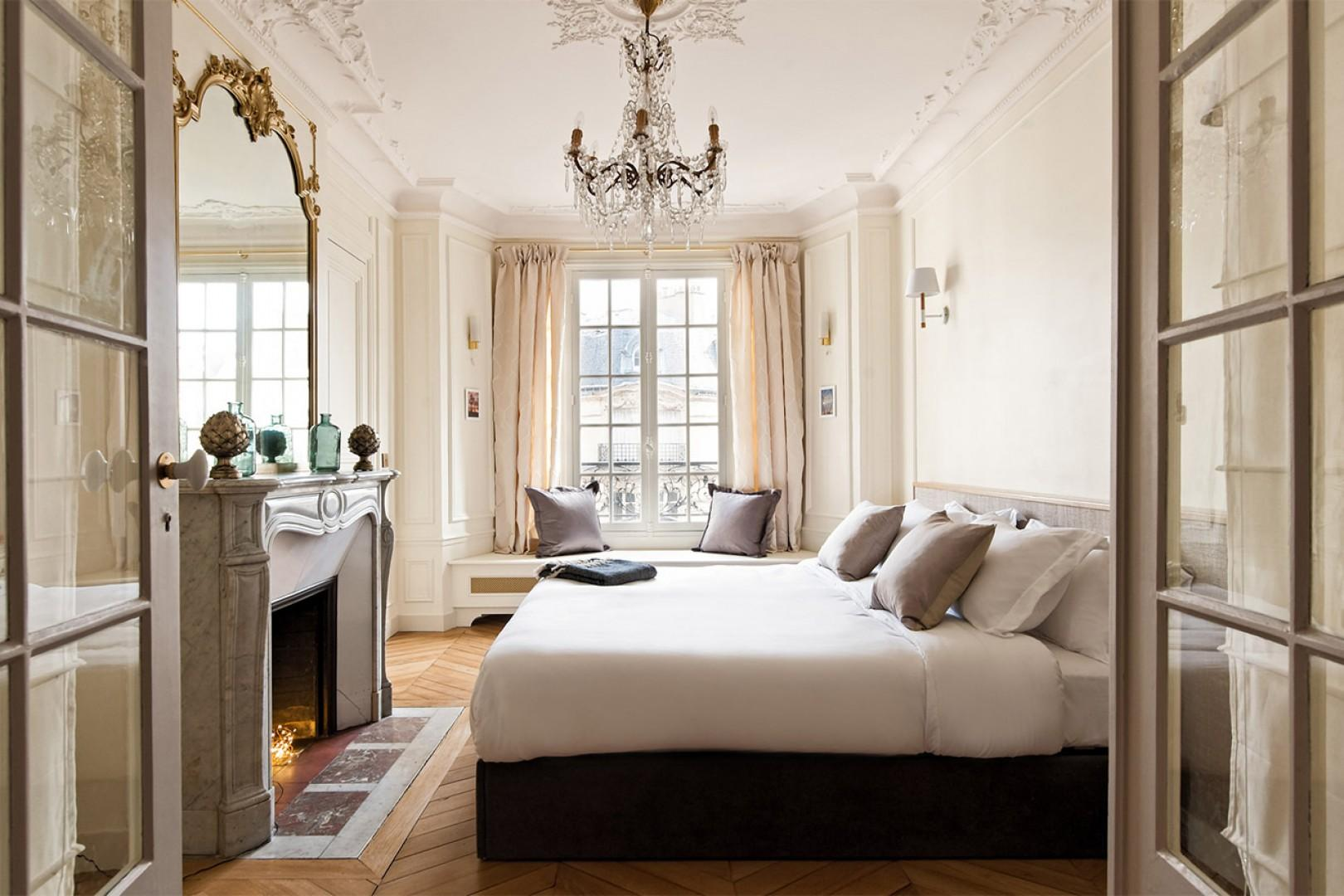 Large double doors open to reveal the stunning bedroom 2.