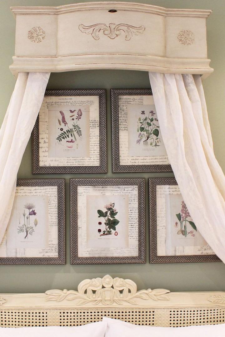 Romantic drapes and delicate flowers above the bed