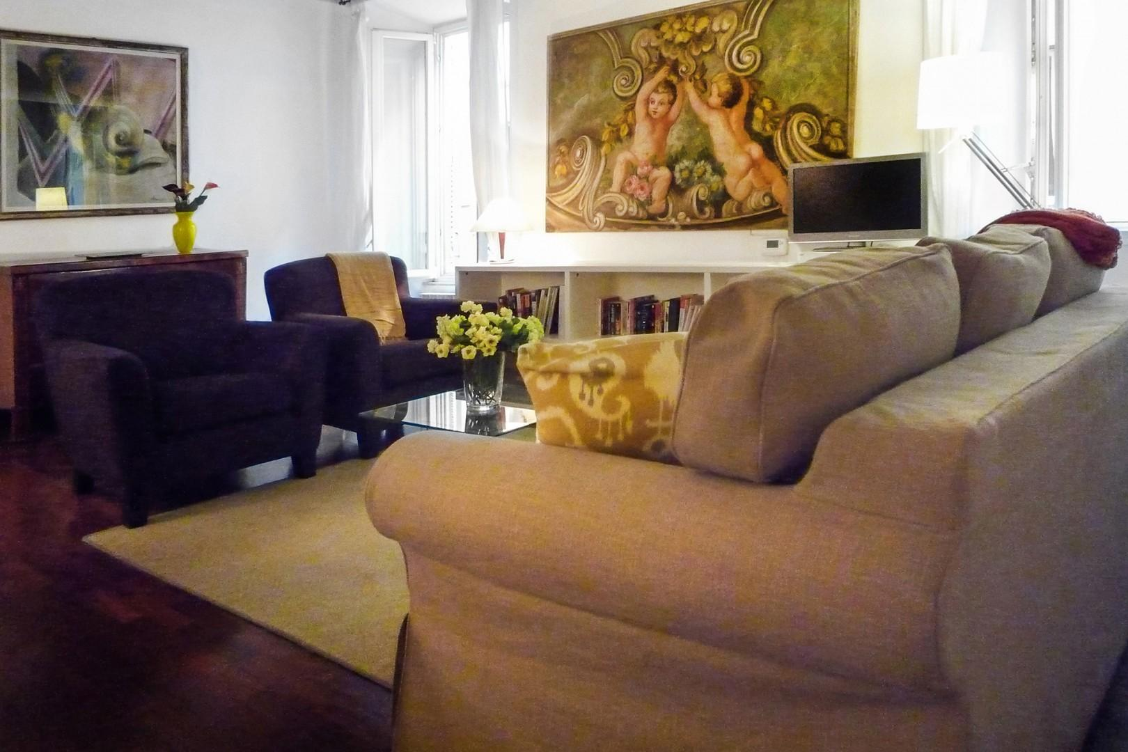 The apartment is decorated with fine taste and quality pieces.