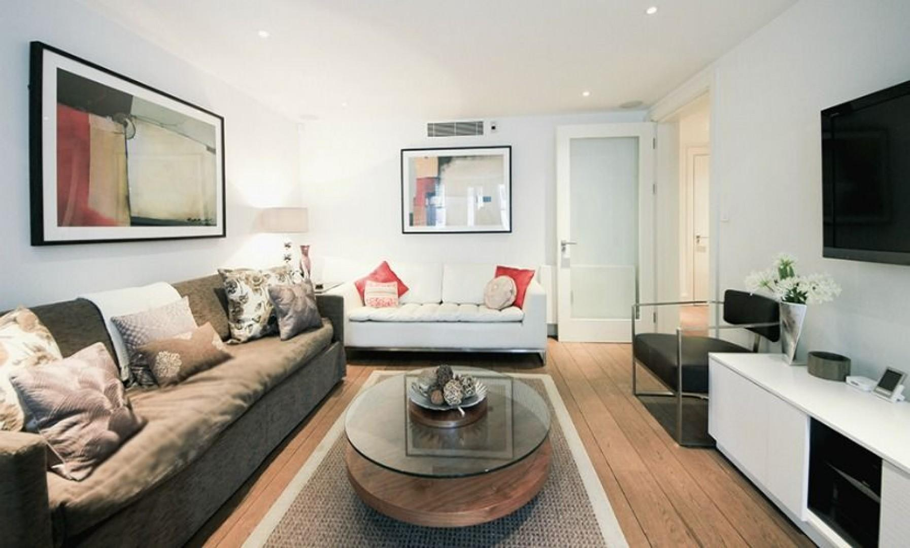 This comfortable living room with a sofa that converts into two beds is roomy and ideal for a family