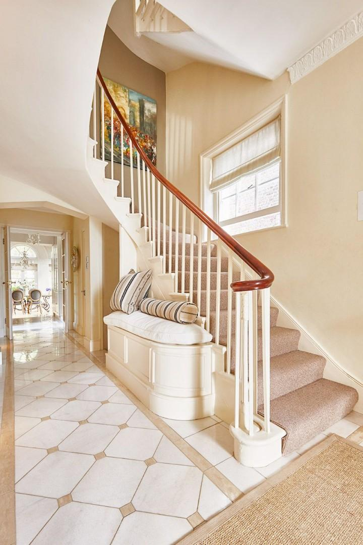 Carpeted staircase leads to the bedrooms upstairs