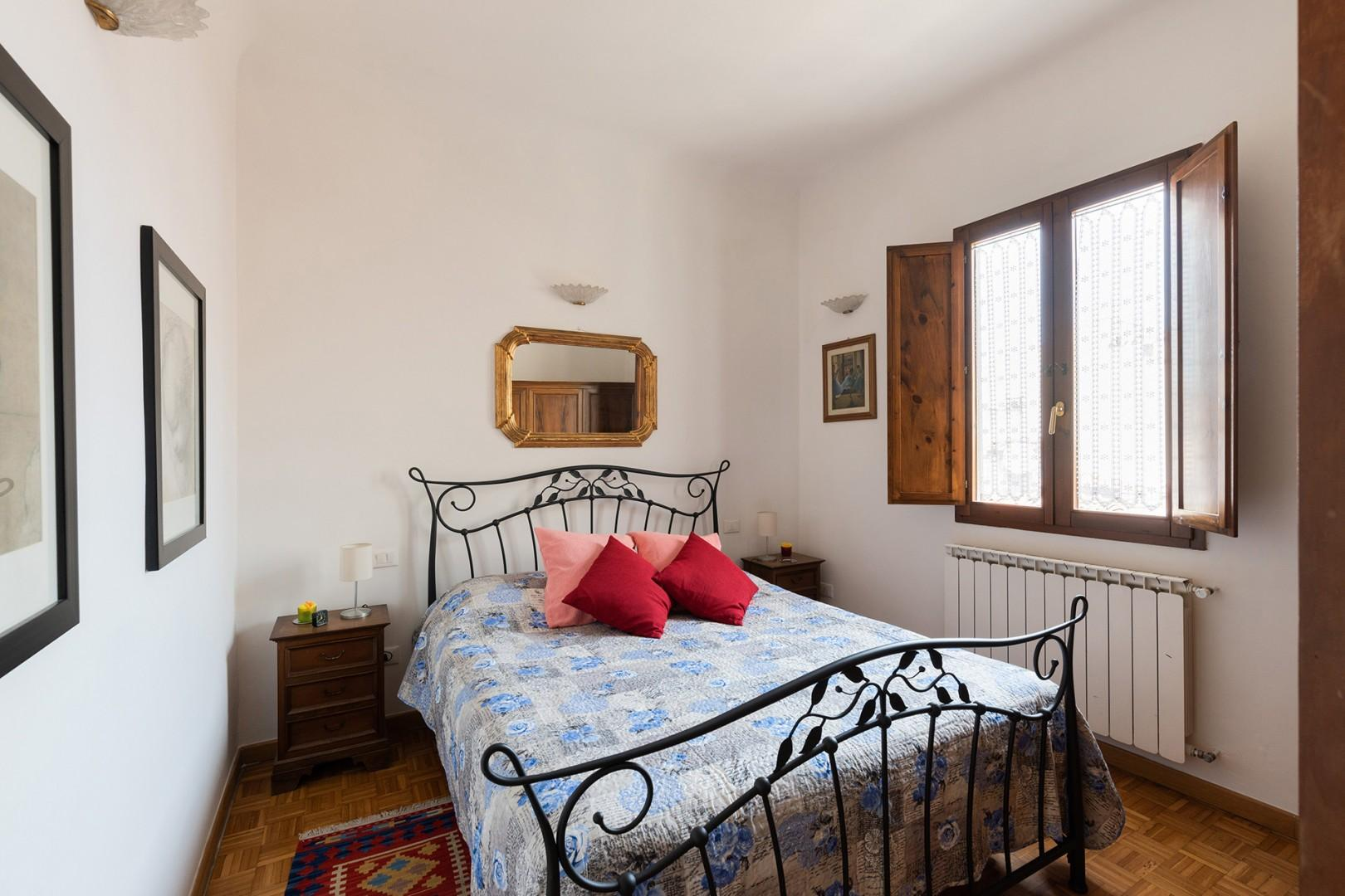 Comfortable bed, plenty of light from the large window.