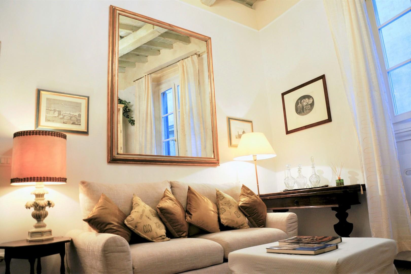 Comfortable living room overlooks Via del Parione and Palazzo Corsini.