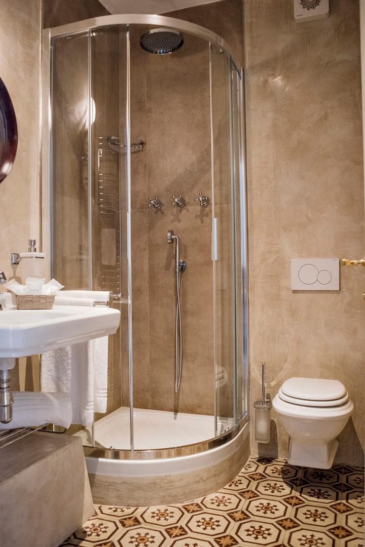 En suite bathroom to bedroom 1 with shower.