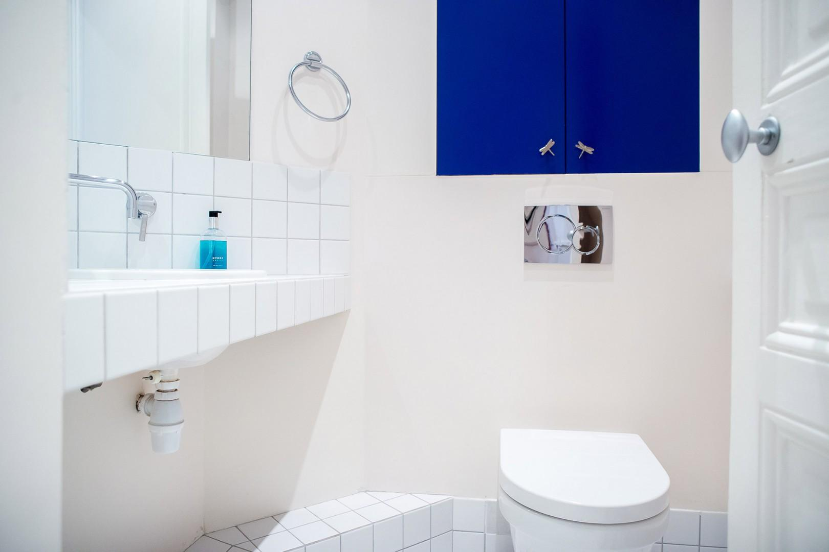 An additional half bath is located near living room.