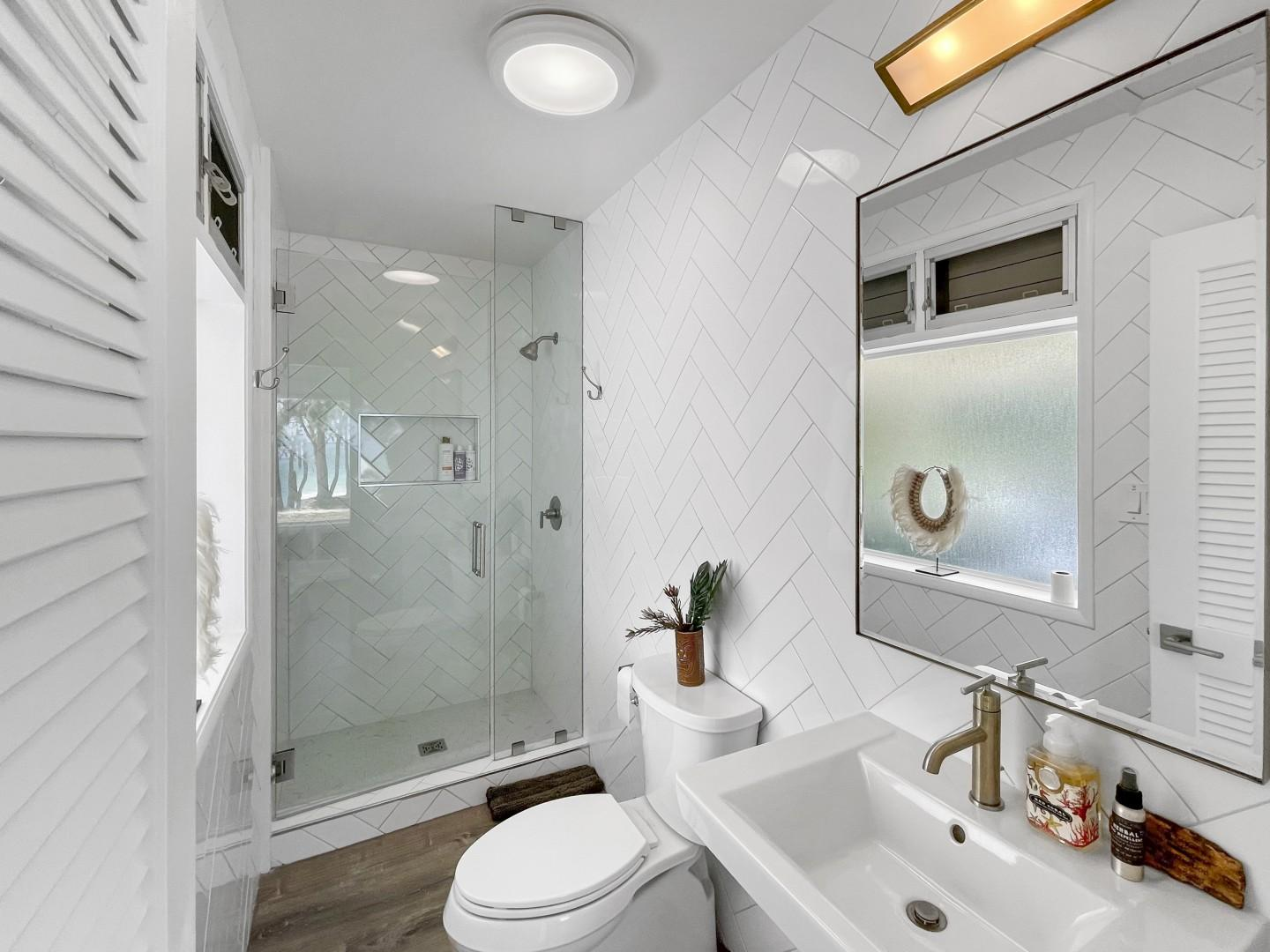 Full bath located off living room, well suited for the guest staying in the kids room.