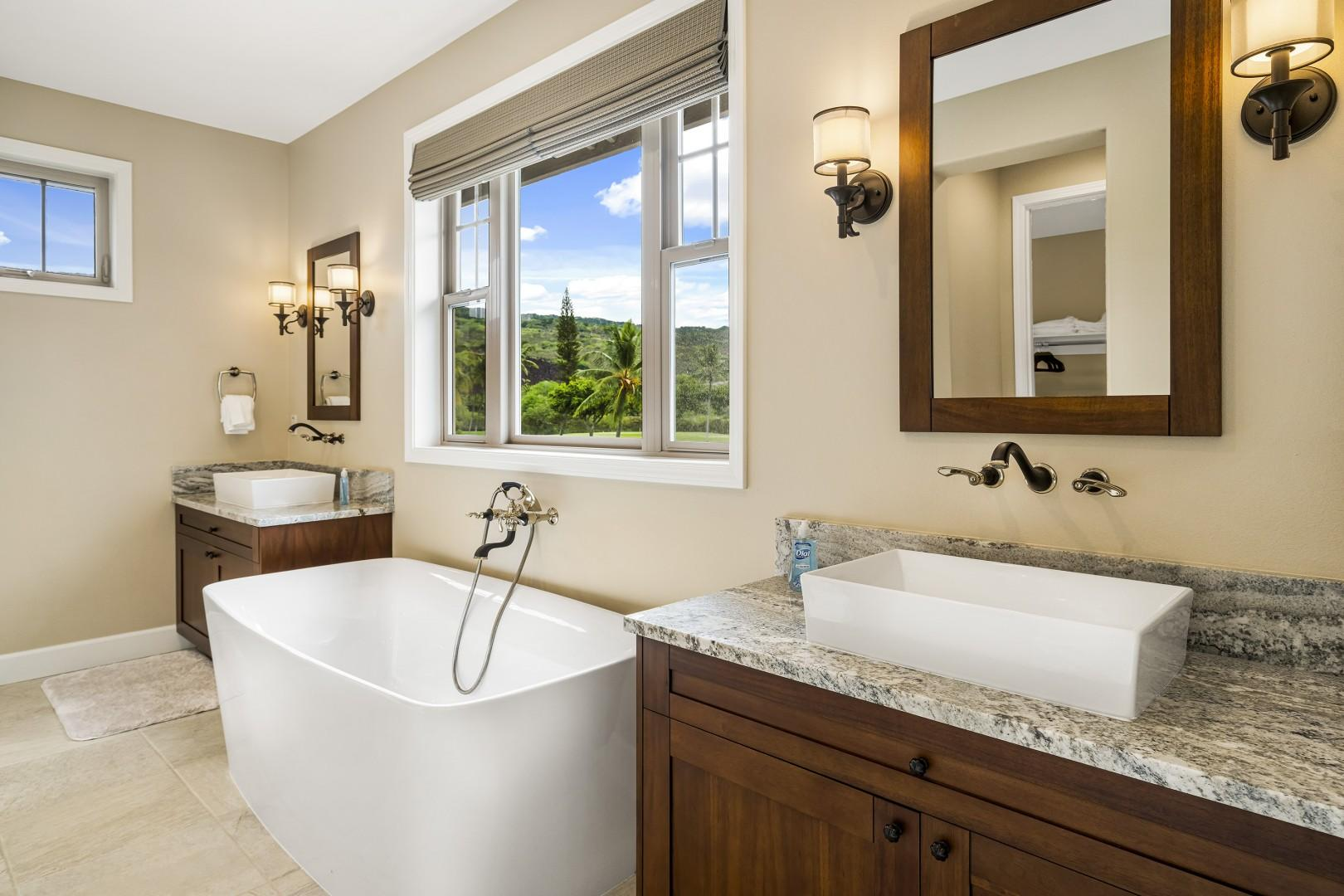 Attached Master bathroom with dual vanities and a soaking tub with views of the Ocean!