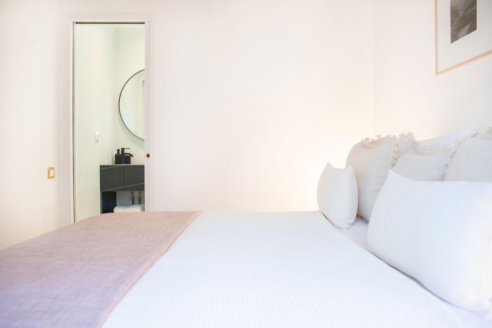 Pamper yourself in the sleek en suite bathroom.