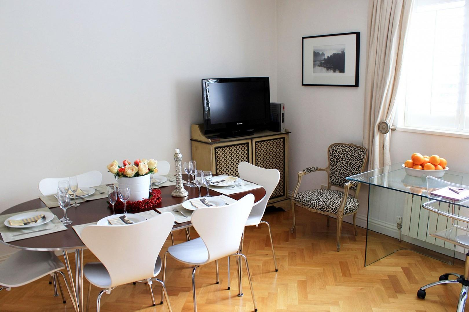 View towards the flat-screen TV and dining table