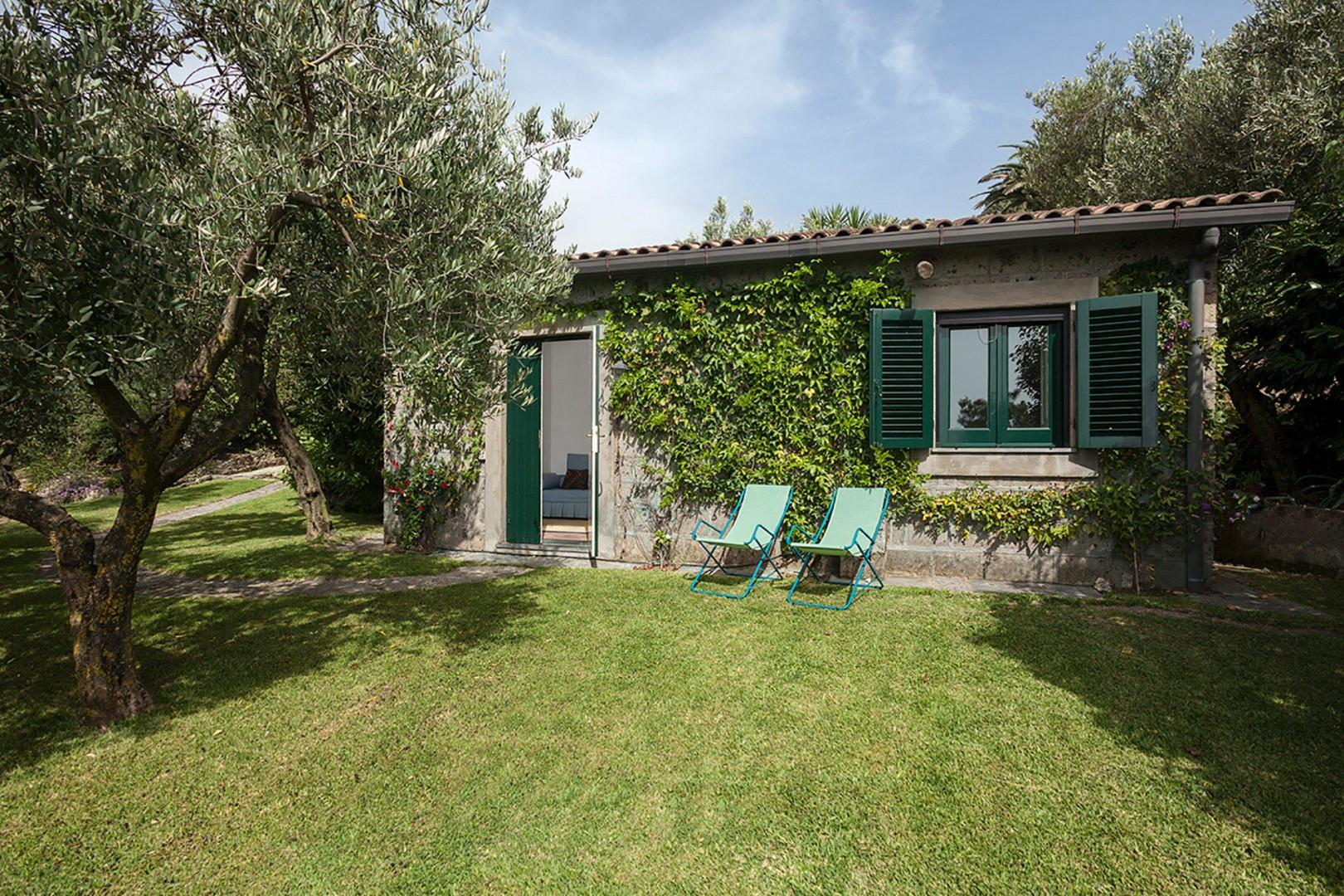 The cottage sleeps 3 more guests. It is on the main grounds, not far from the pool but isolated.