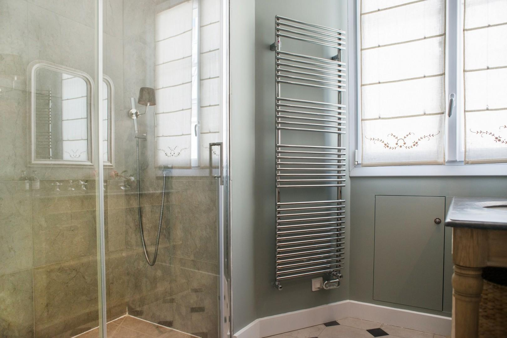 There is a practical towel warmer in bathroom 1.