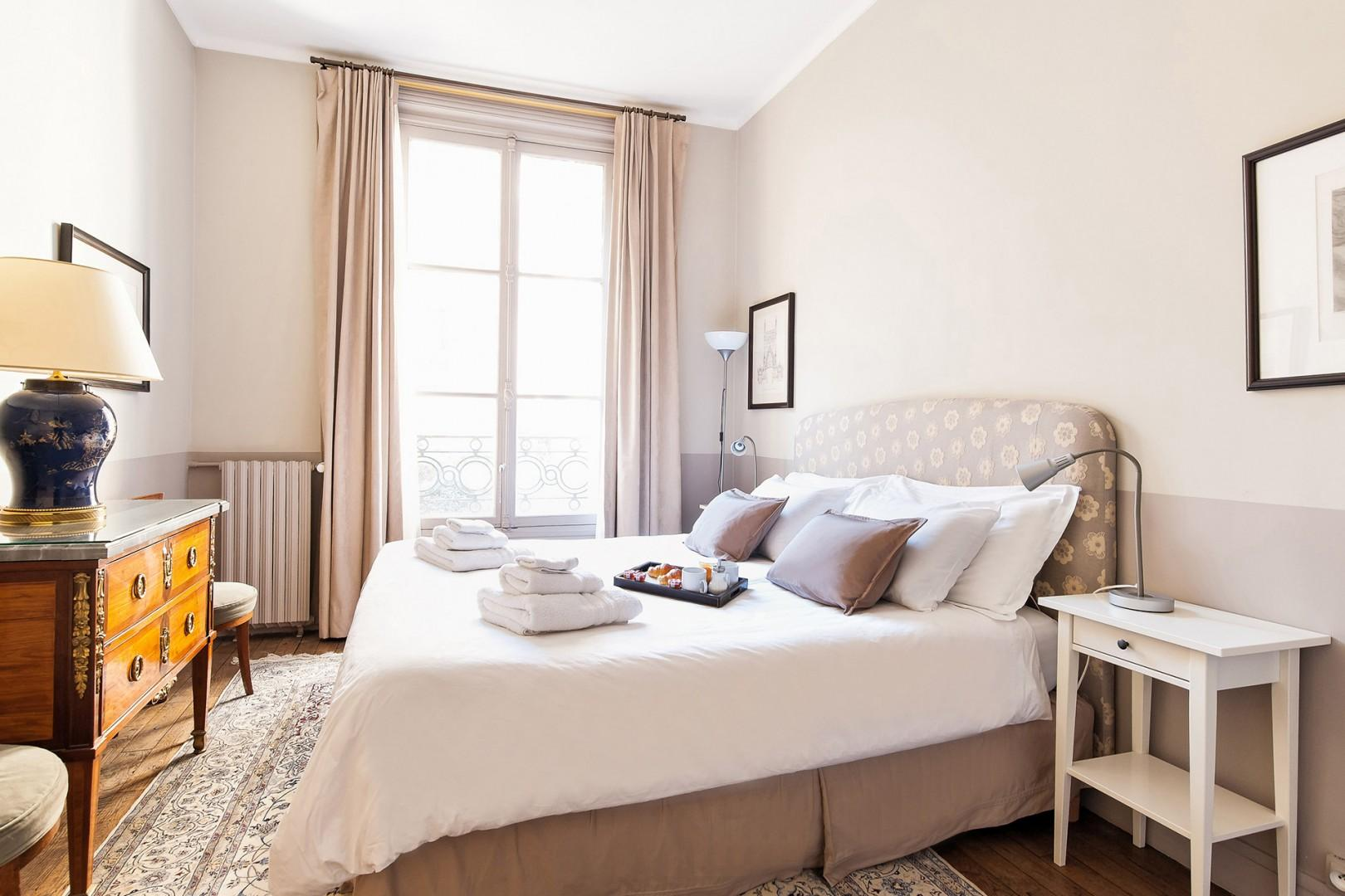 French windows and reading lamps provide plenty of natural light.