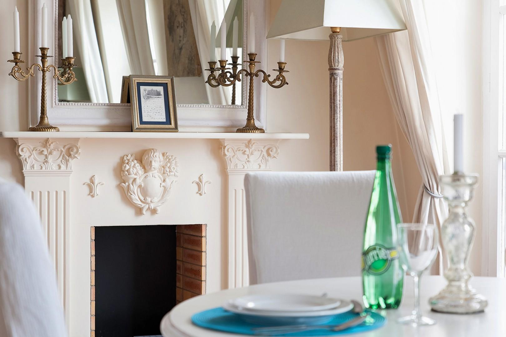 The intricate fireplace gives the rental a classic charm.