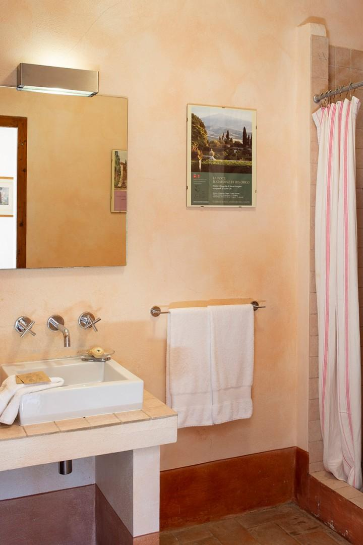 En suite bathroom is fitted with a shower, sink, toilet and bidet.