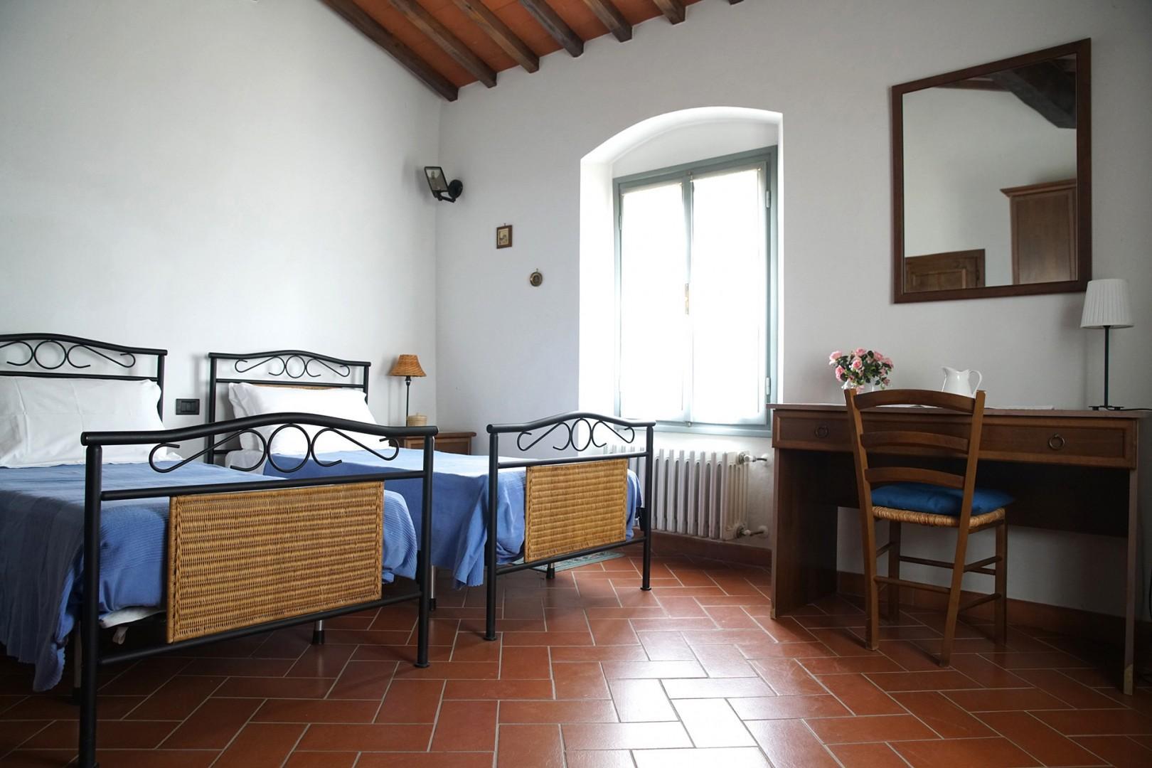 Bedroom 2 has two beds with and en suite bathroom.