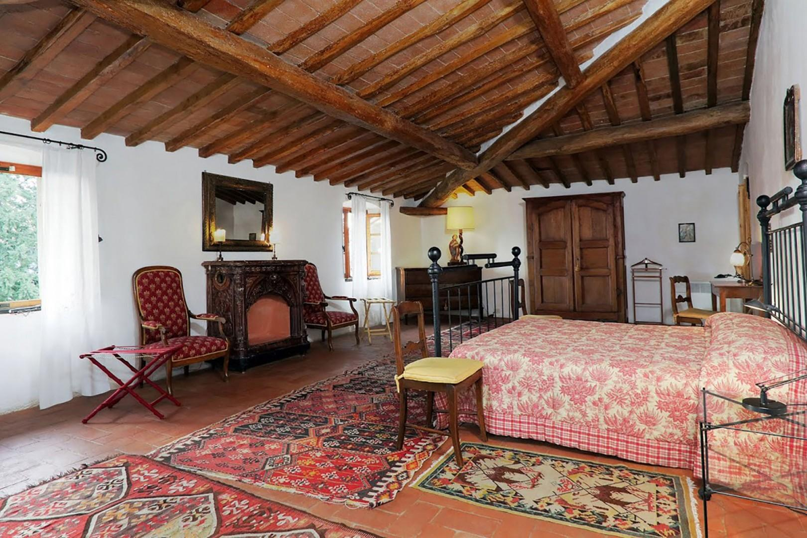 Large bedroom 1 equipped with easy chair and a desk has an en suite bathroom.