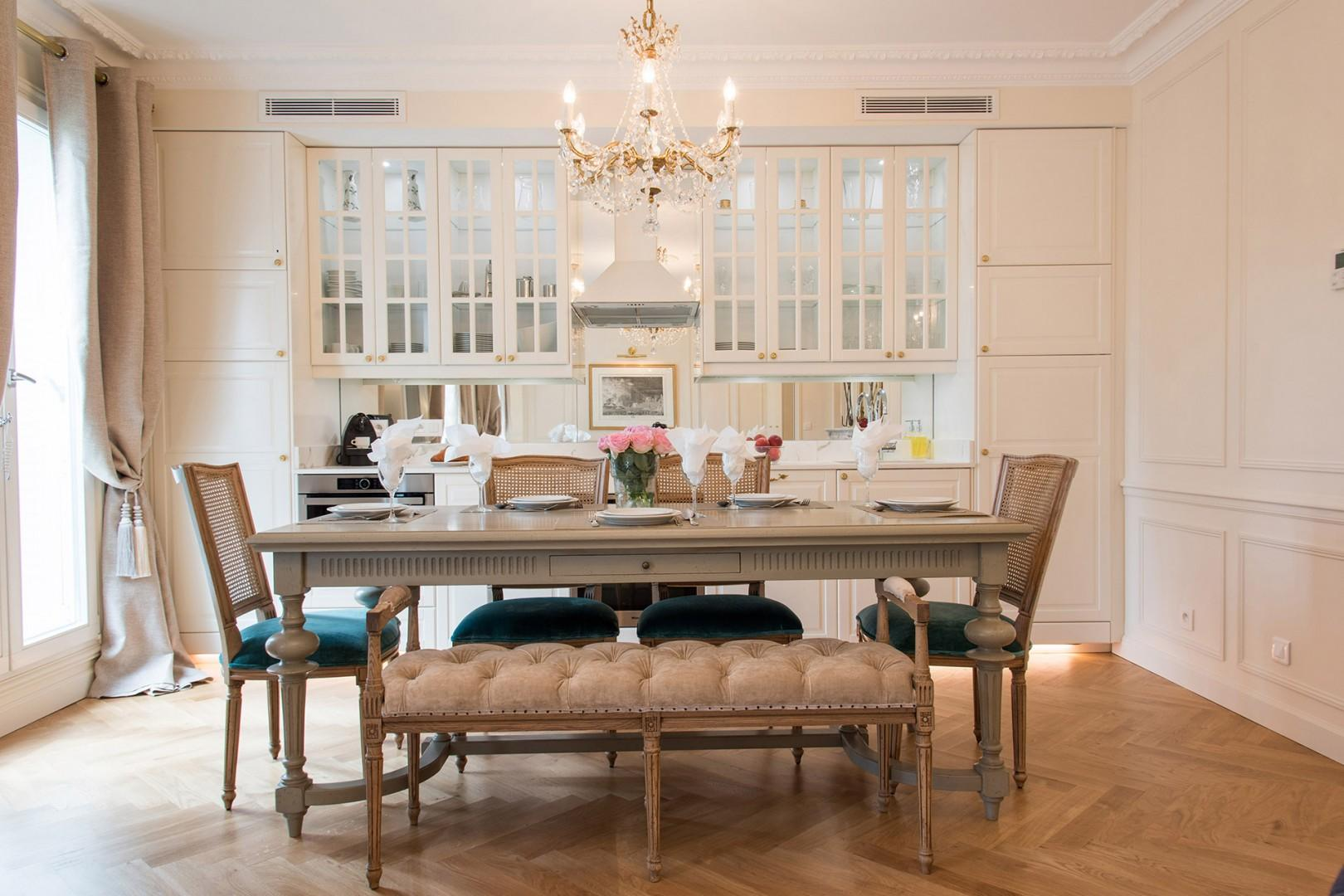 The large dining table comfortably seats eight guests.