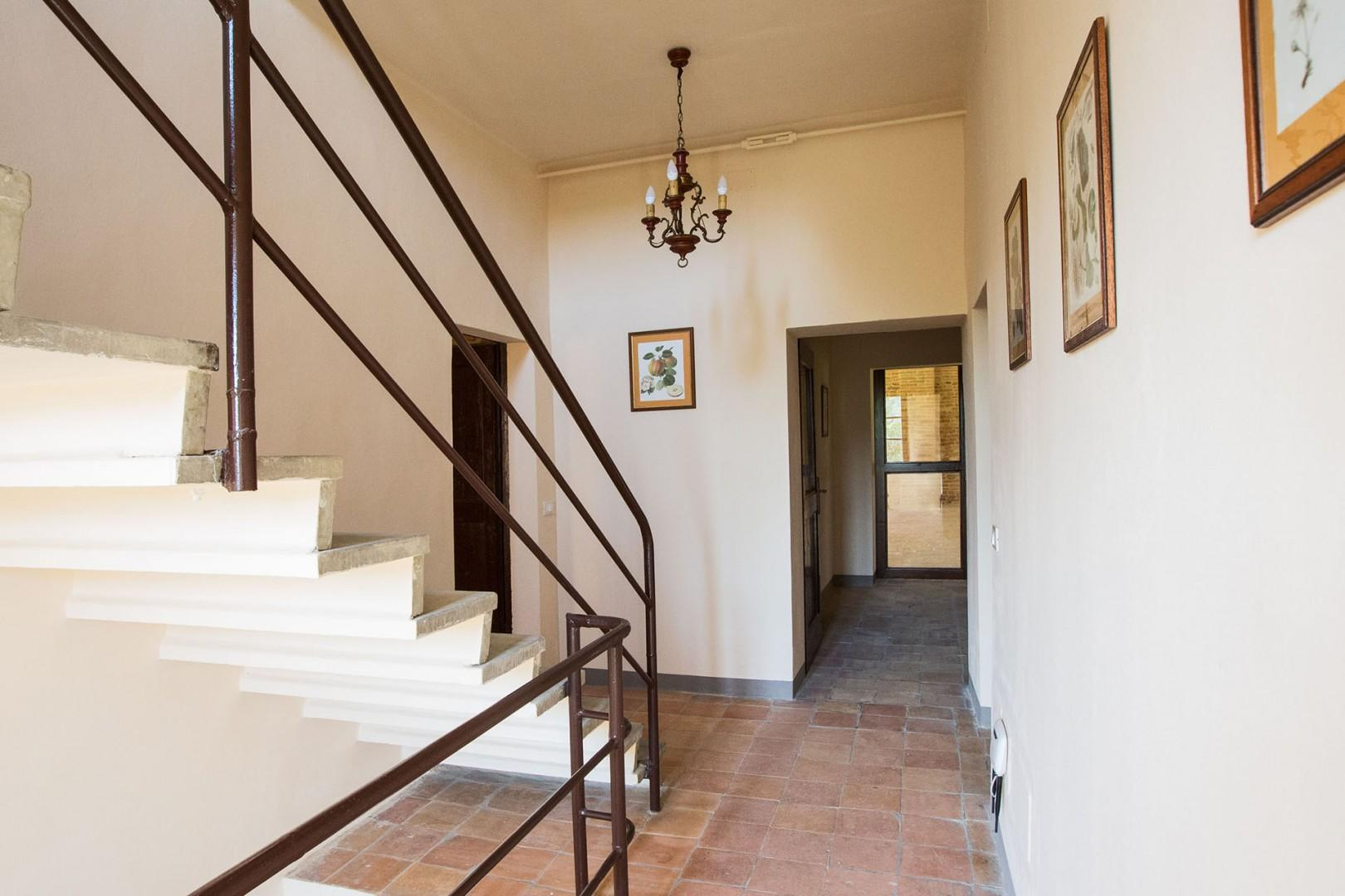 Stair case that rises to the 3rd floor (2nd floor European).