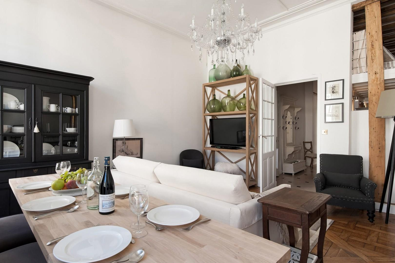 The sleek dining table is located in the open-plan living room.