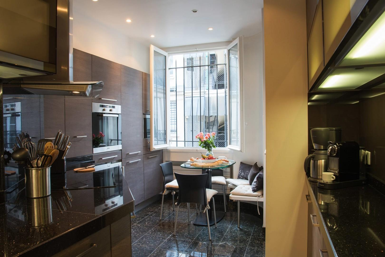 The fully equipped kitchen has a dishwasher and Nespresso machine.