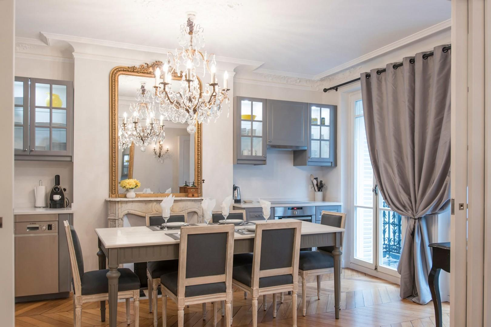 Dine with friends and family underneath a lovely chandelier.