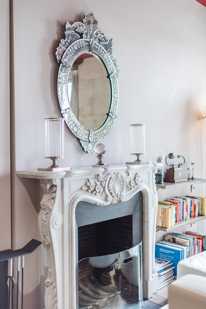 The elegant decorative fireplace is a feature in the living room.