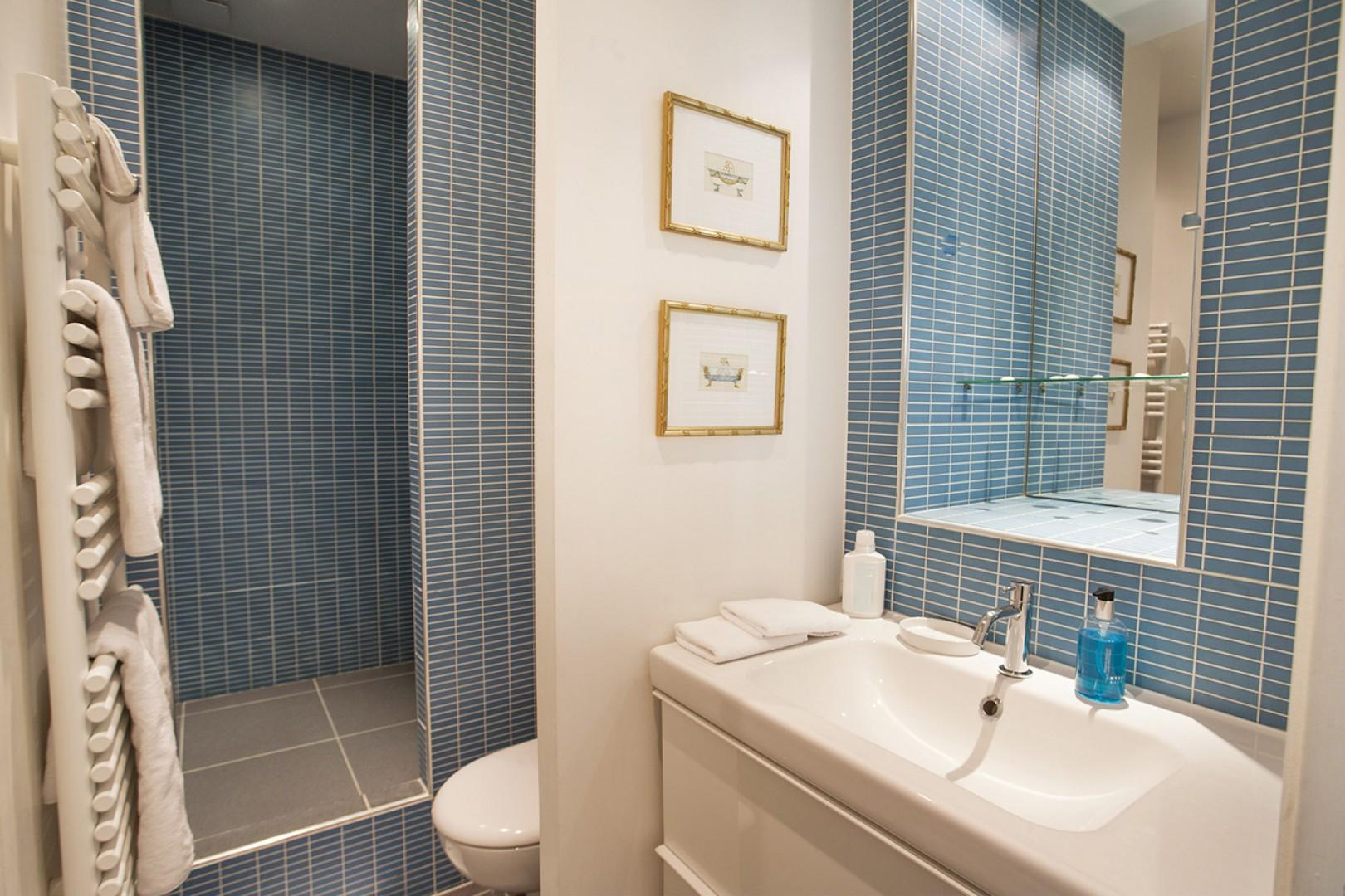 Start your day in the cozy bathroom, which features a heated towel rack for extra comfort.