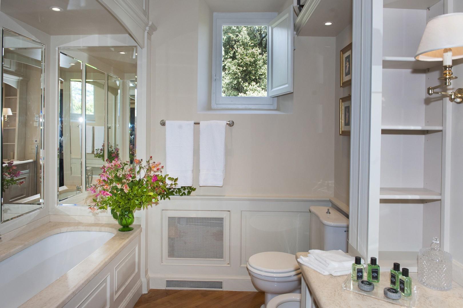 Bathroom 1 has a shower, bathtub, sink, toilet and bidet.