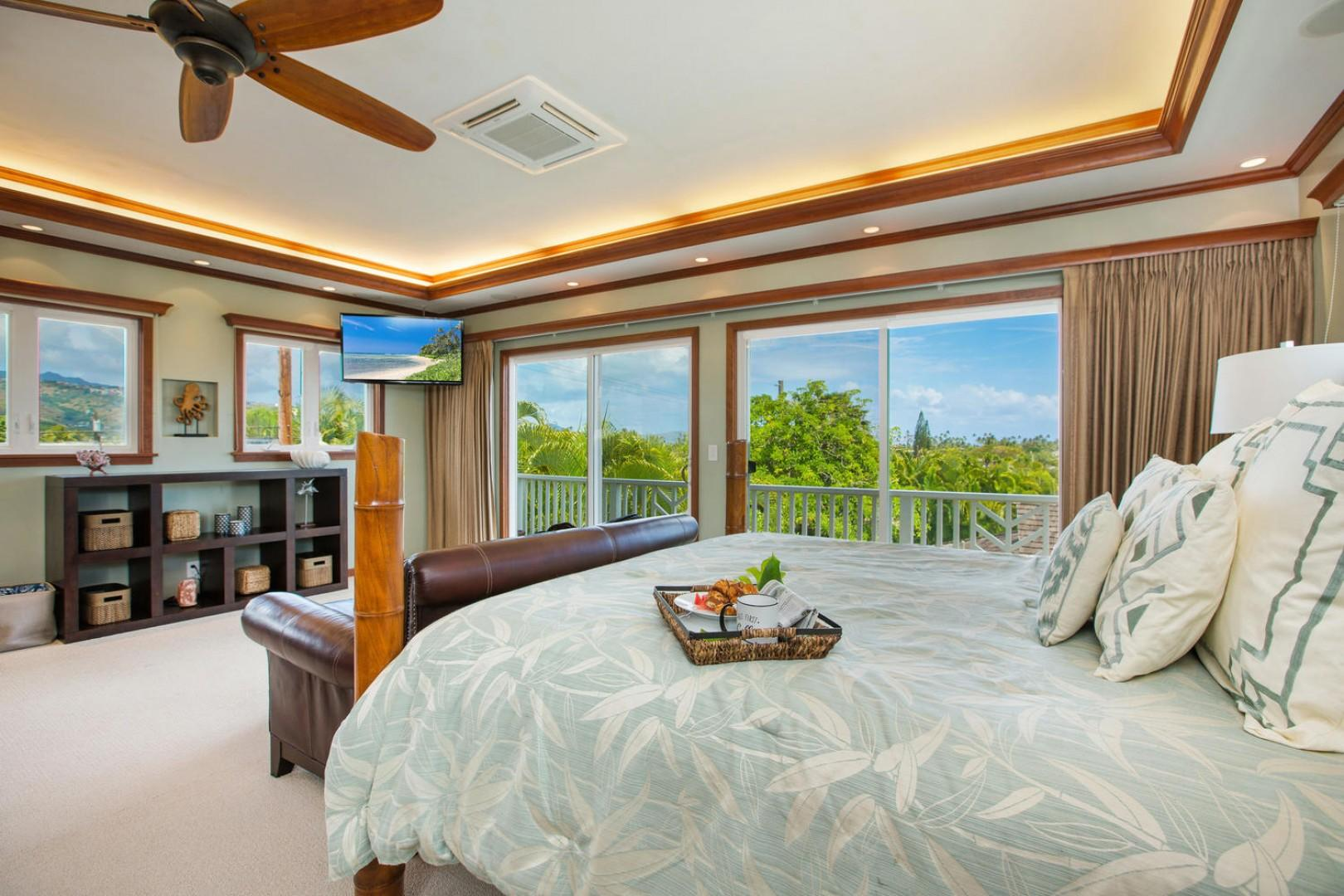 The master bedroom with peek-a-boo ocean views and gorgeous mountain views.