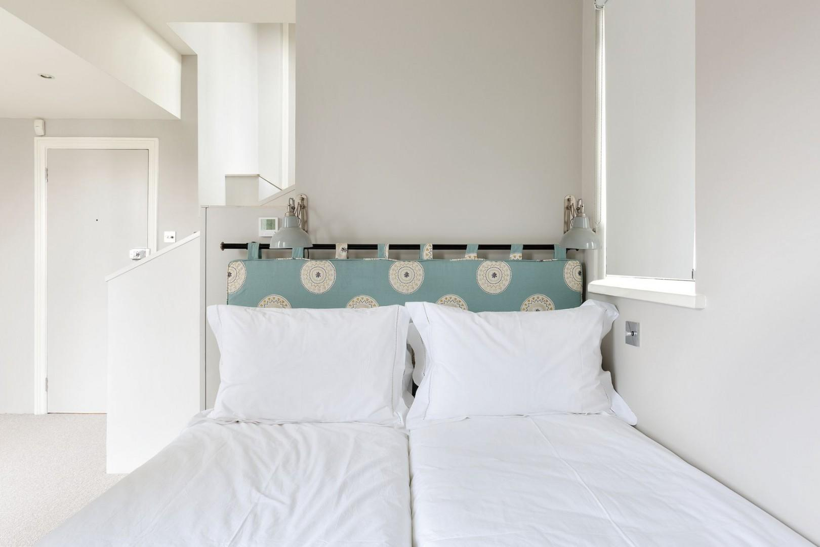 The comfortable third bedroom with a minimal vibe