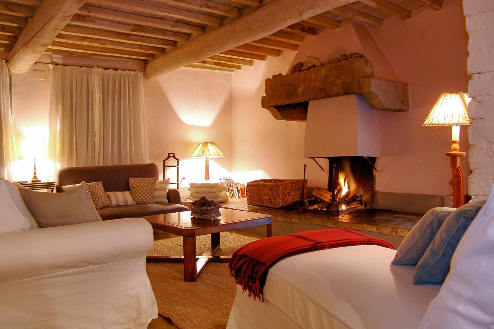 Original wooden ceiling beams add to the rustic charm.